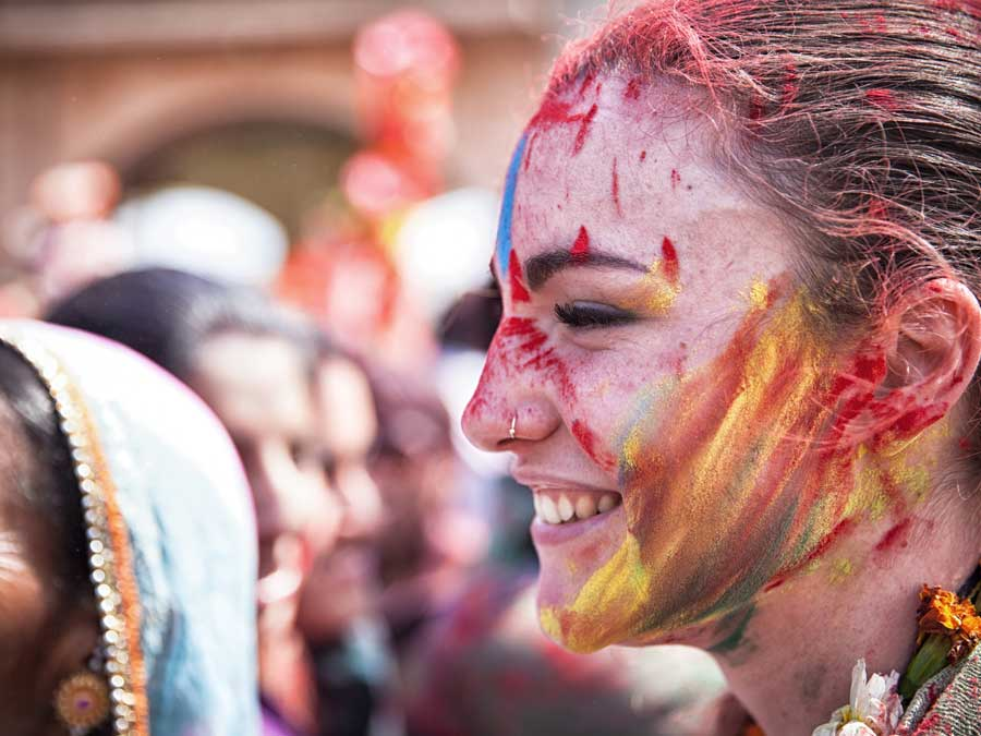 Happy young woman celebrating Holi in India