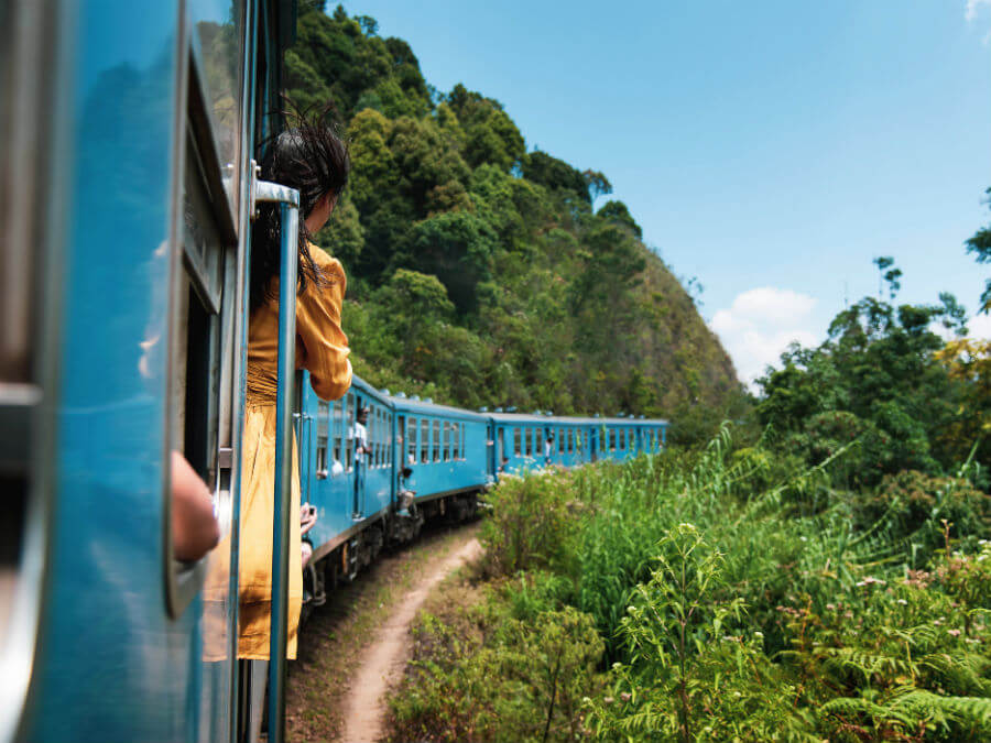 Woman on train in Sri Lanka