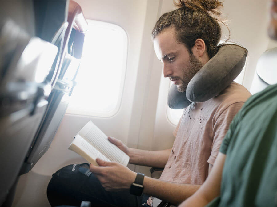Man reading on a flight
