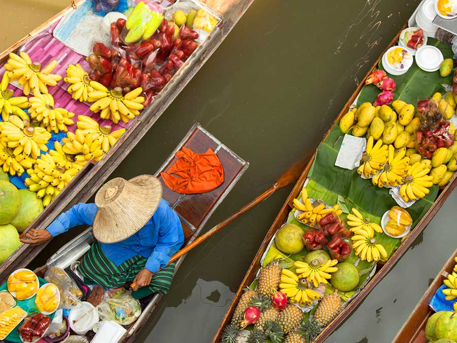 Floating market in Bangkok, Thailand - Countries where travel insurance is compulsary