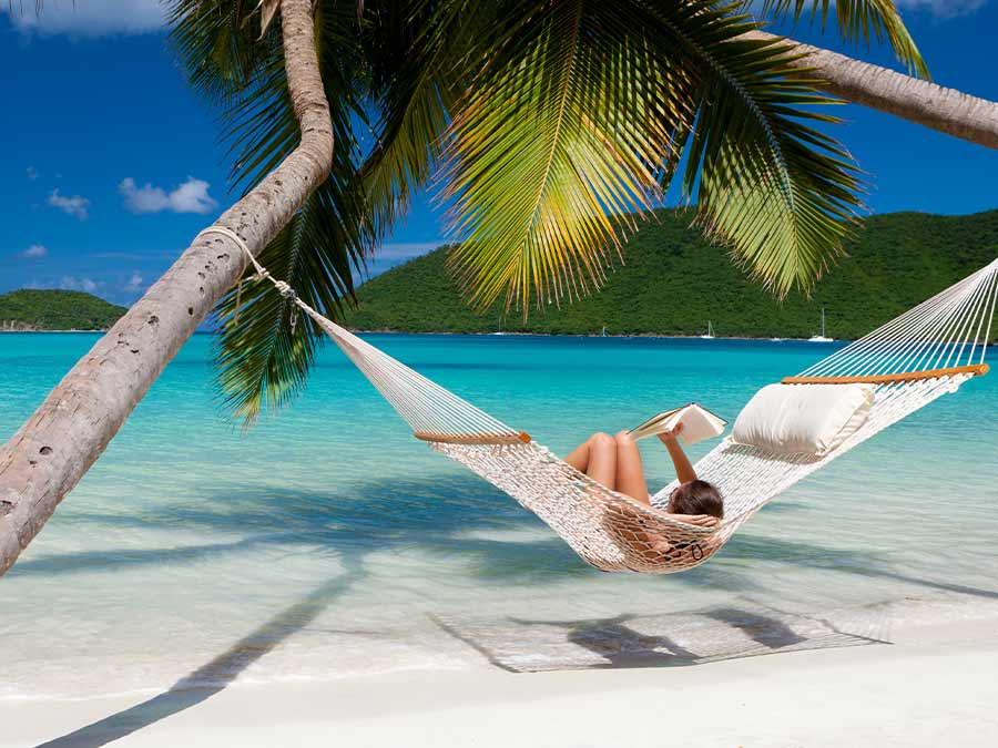 Woman relaxing on hammock