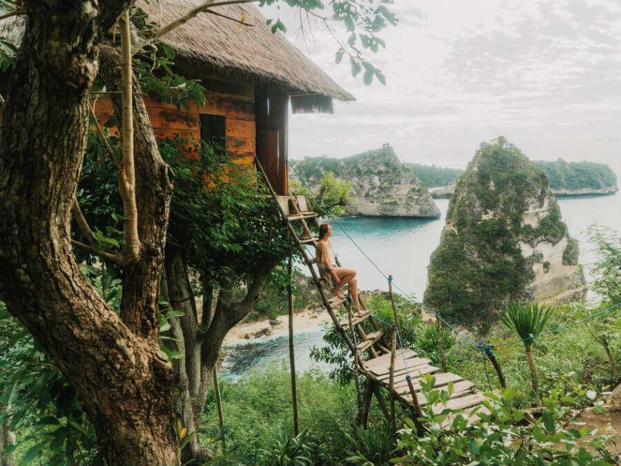 Woman in a tree house, Bali